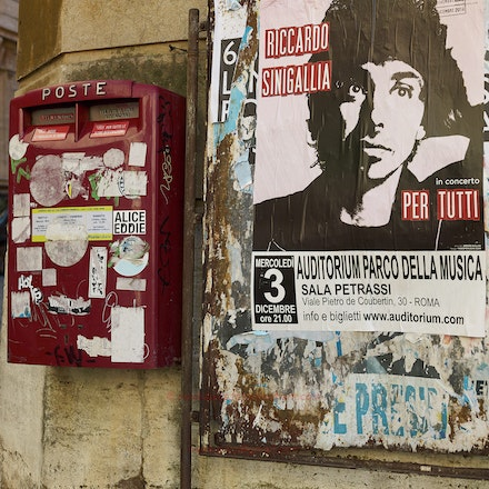 A Roman postbox and poster