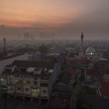 Jakarta from a Balkony - One week in a hotel room in Jakarta, seeing the sunrises, hearing the mosques and seeing the city wake up and go to sleep.