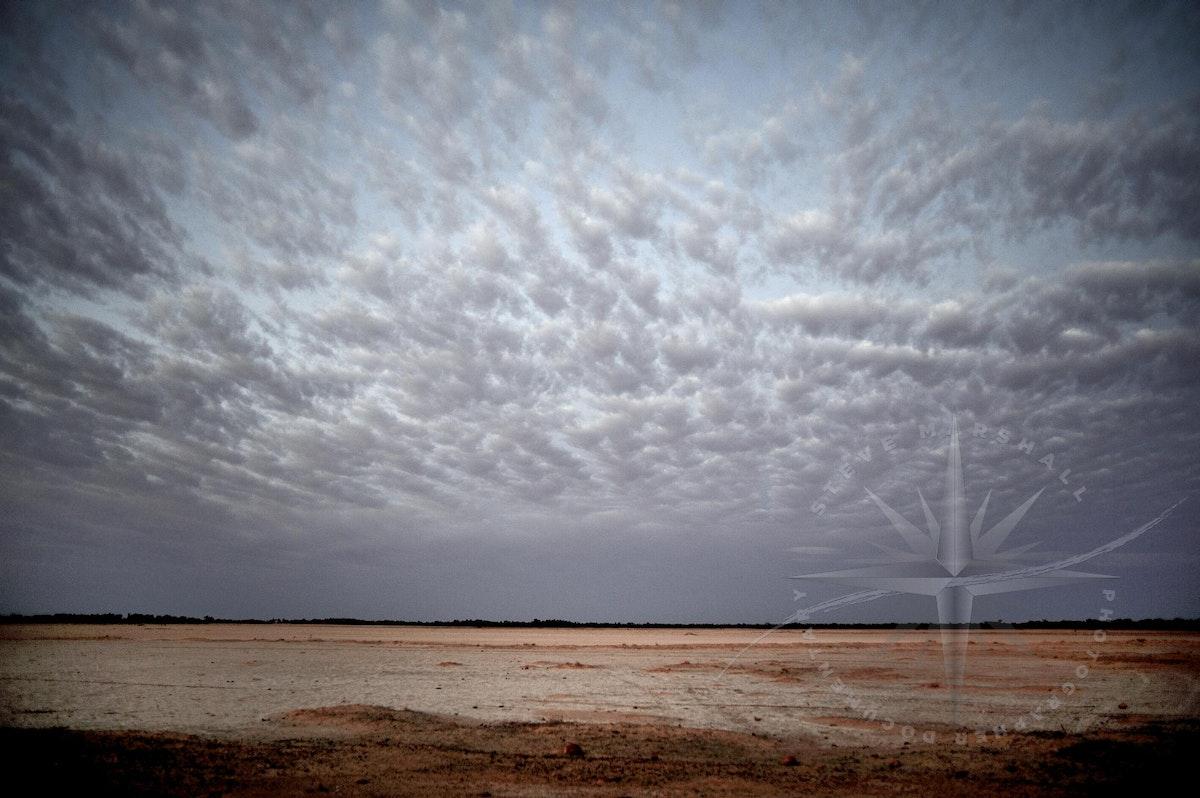 Cloud over salt flat - Strato cloud over salt flat near Quilpie QLD. Outback Australia Documentary © Steve Marshall