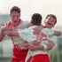 Winning hug - Players celebrate a game-winning goal at a middle school soccer tournament.