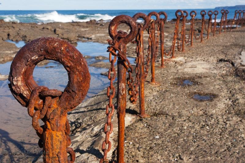 Rusty chains, Bogey hole, Newcastle - Rusty metal chain at the bogey hole, Newcastle