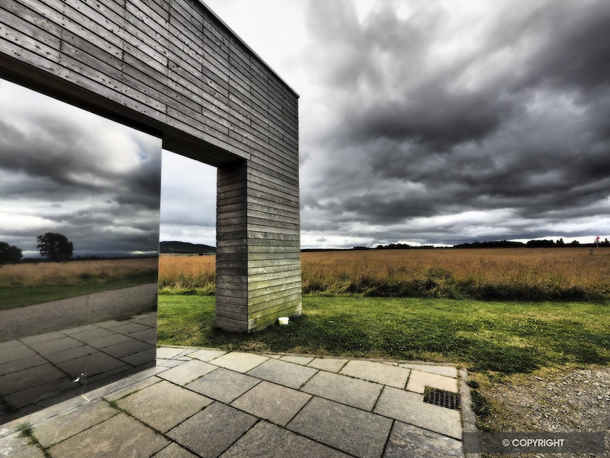 Culloden Battlefield Reflected - The Culloden Battlefield of 1746, site of the last pitched battle on British soil, is reflected in the window of the battlefield...