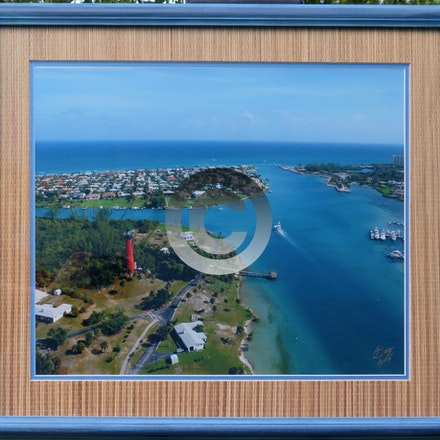 JUPITER INLET - This Aerial is double matted with a hand made rattan mat to match the blue beveled frame.